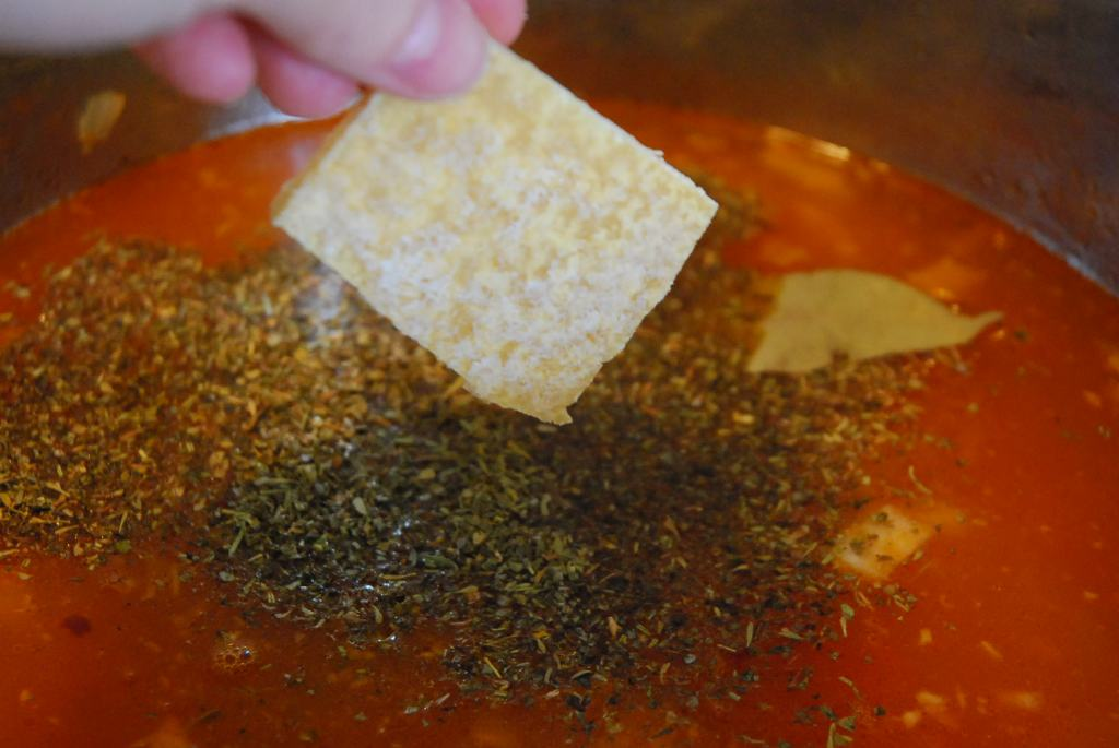 Drop in the Parmesan rind