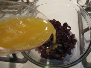 Microwave the orange juice and dried cranberries